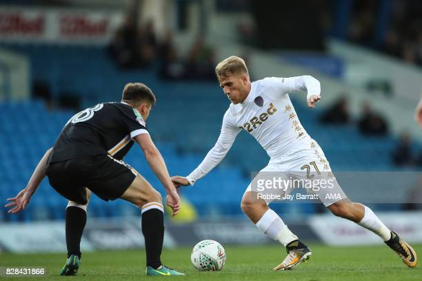 Billy Reeves of Port Vale and Samuel Saiz of Leeds United during the Carabao Cup First Round match between Leeds United and Port Vale at Elland Road...