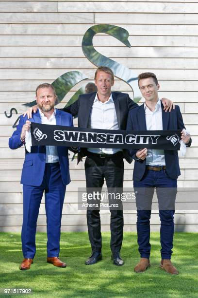 Billy Reid Graham Potter and Kyle Macaulay during the unveiling of the new manager Graham Potter at The Fairwood Training Ground on June 11 2018 in...