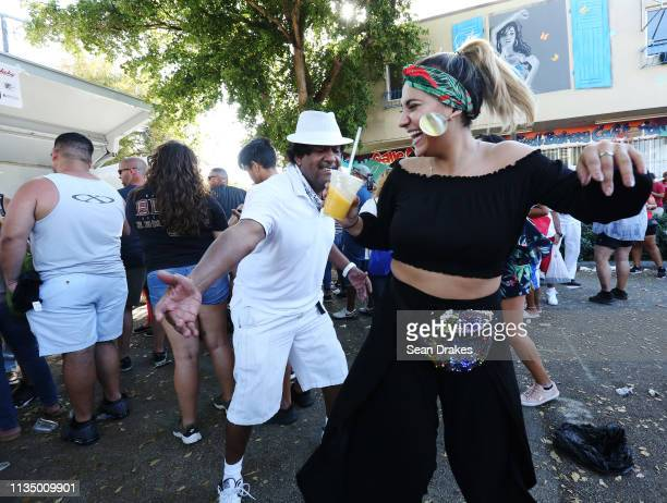 Billy Rivera and Revati Beal dance during the annual Calle Ocho Festival in the Little Havana community on March 10 2019 in Miami Florida