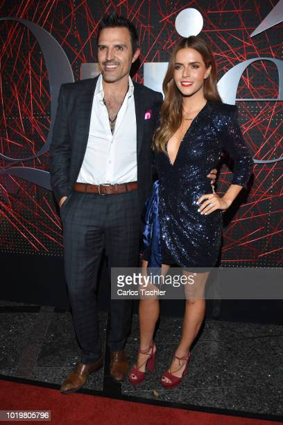 Billy Rovzar and Claudia Alvarez pose for photos during the red carpet for 'Quien' magazine's 18th anniversary at Foro Masaryk on August 15 2018 in...