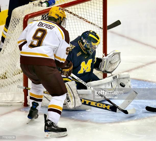 Billy Sauer of the Michigan Wolverines stops a shot from Kyle Okposo of the Minnesota Gophers on October 13 2007 at the Xcel Energy Center in St Paul...