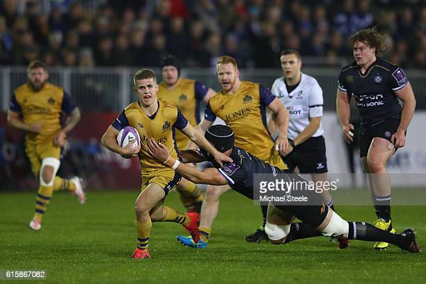 Billy Searle of Bristol is held up by Luke Charteris of Bath during the European Rugby Challenge Cup Pool Four match between Bath Rugby and Bristol...