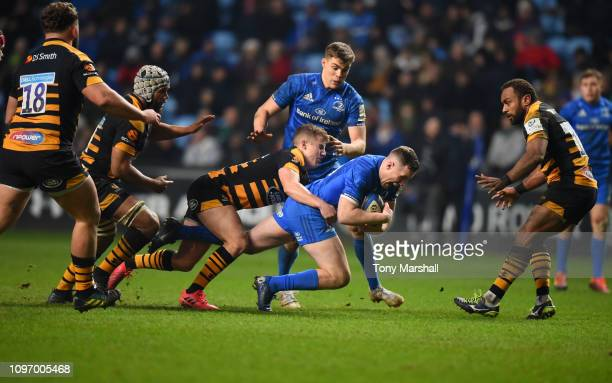 Billy Searle of Wasps tackles Rory O'Loughlin of Leinster during the Champions Cup match between Wasps and Leinster Rugby at Ricoh Arena on January...