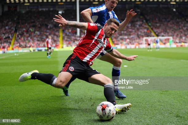 Billy Sharp Captain of Sheffield United is challenged by Tom Anderson of Chesterfield during the Sky Bet League One match between Sheffield United...