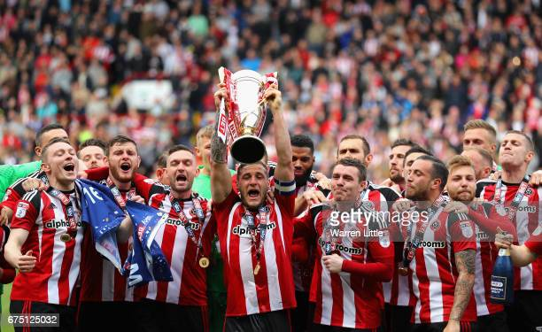 Billy Sharp, Captain of Sheffield United raises the Sky Bet League One trophy and celebrates winning promotion into next seasons Sky Bet Championship...