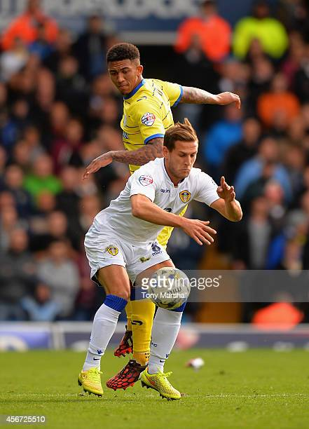 Billy Sharp of Leeds United shields the ball from Liam Palmer of Sheffield Wednesday during the Sky Bet Championship match between Leeds United and...