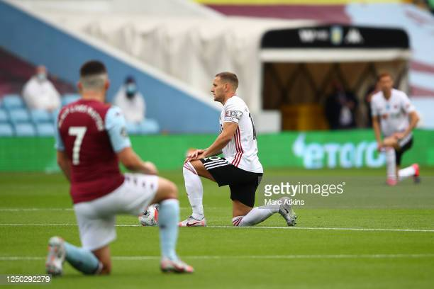 Billy Sharp of Sheffield United, along with his teammates and opposition, 'Take a Knee' in support of the Black Lives Matter movement after the...