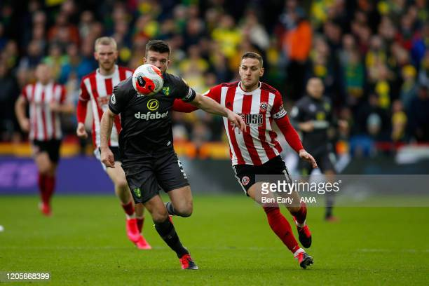 Billy Sharp of Sheffield United and Grant Hanley of Norwich City during the Premier League match between Sheffield United and Brighton Hove Albion at...