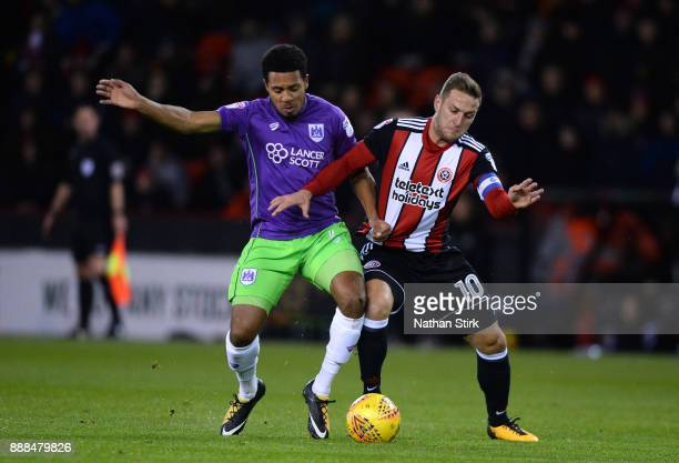Billy Sharp of Sheffield United and Korey Smith of Bristol City in action during the Sky Bet Championship match between Sheffield United and Bristol...