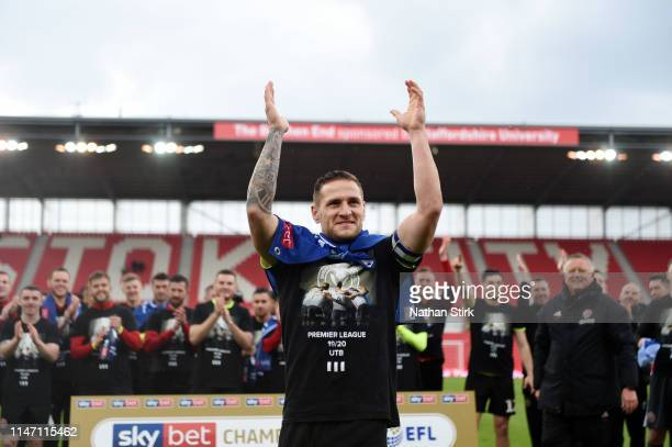 Billy Sharp of Sheffield United and teammates celebrate their promotion after the Sky Bet Championship match between Stoke City and Sheffield United...