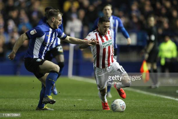 Billy Sharp of Sheffield United and Tom Lees of Sheffield Wednesday during the Sky Bet Championship match between Sheffield Wednesday and Sheffield...
