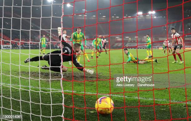 Billy Sharp of Sheffield United beats Sam Johnstone of West Bromwich Albion to score their second goal during the Premier League match between...