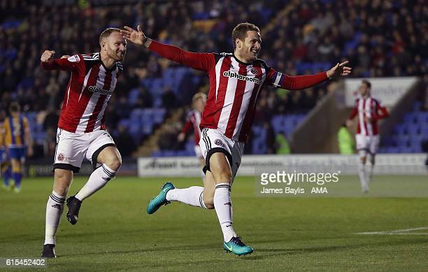Billy Sharp of Sheffield United celebrates after scoring a goal to make it 01 during the Sky Bet League One match between Shrewsbury Town and...