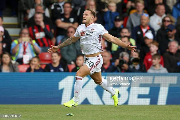Billy Sharp of Sheffield United celebrates after scoring his team's first goal during the Premier League match between AFC Bournemouth and Sheffield...