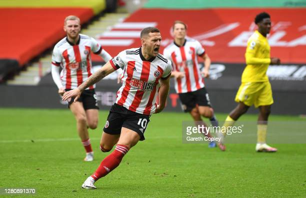 Billy Sharp of Sheffield United celebrates after scoring his team's first goal during the Premier League match between Sheffield United and Fulham at...