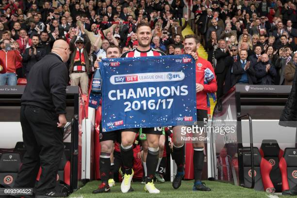 Billy Sharp of Sheffield United celebrates winning promotion to the Sky Bet Championship after the Sky Bet League One match between Sheffield United...