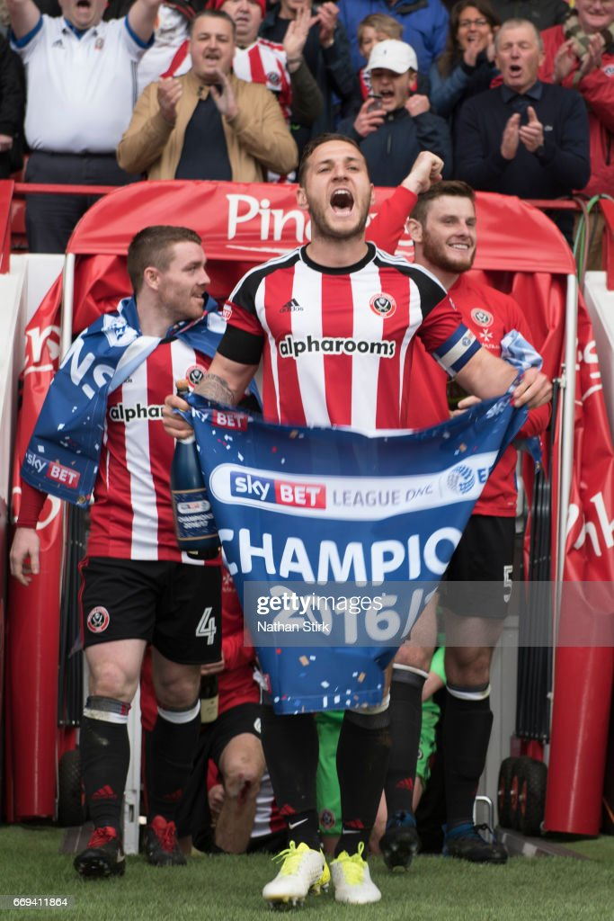 Billy Sharp of Sheffield United celebrates winning promotion to the Sky Bet Championship after the Sky Bet League One match between Sheffield United and Bradford City at Bramall Lane on April 17, 2017 in Sheffield, England.