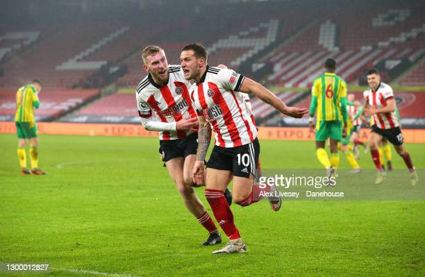 Billy Sharp of Sheffield United celebrates with Oli McBurnie after scoring their second goal during the Premier League match between Sheffield United...