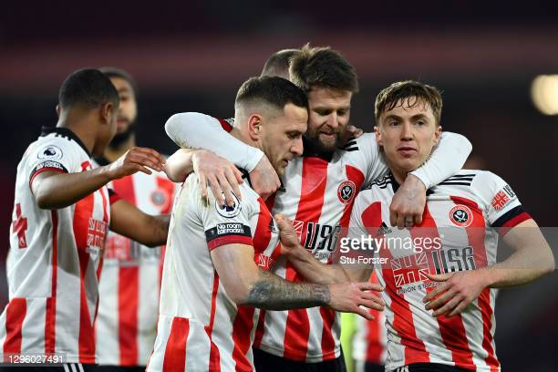 Billy Sharp of Sheffield United celebrates with Oliver Norwood and Ben Osborn after scoring a penalty for his side's first goal during the Premier...