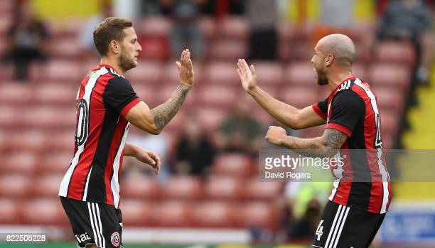 Billy Sharp of Sheffield United celebrates with team mate Samir Carruthers after scoring the first goal during the pre season friendly match between...