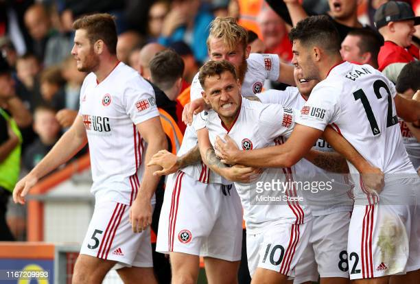 Billy Sharp of Sheffield United celebrates with teammates after scoring his team's first goal during the Premier League match between AFC Bournemouth...
