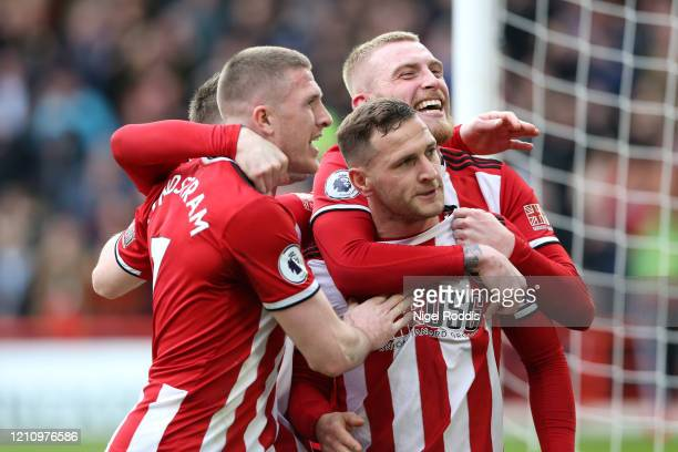 Billy Sharp of Sheffield United celebrates with teammates after scoring their teams first goal during the Premier League match between Sheffield...