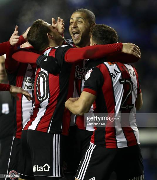 Billy Sharp of Sheffield United celebrates with teammates Leon Clarke and George Baldock after scoring the opening goal during the Sky Bet...