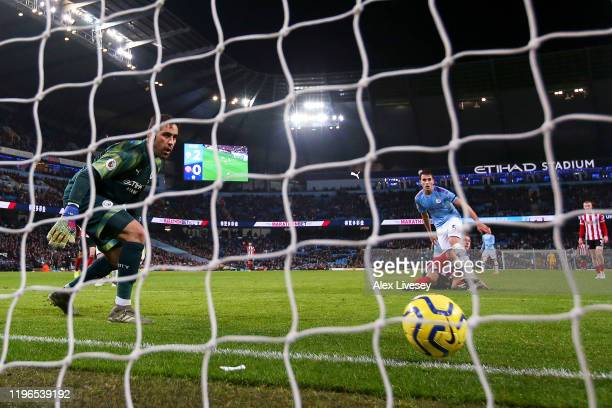 Billy Sharp of Sheffield United heads the ball but hits the post which rolls along the goal line but fails to go in as Claudio Bravo of Manchester...