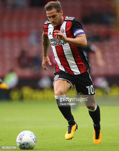 Billy Sharp of Sheffield United runs with the ball during the pre season friendly match between Sheffield United and Stoke City at Bramall Lane on...