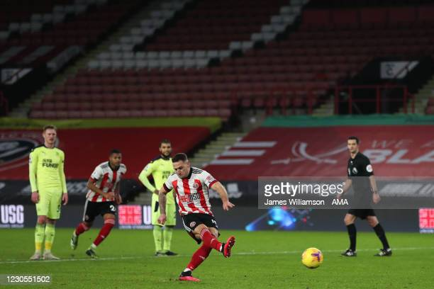 Billy Sharp of Sheffield United scores a goal to make it 1-0 and make it his 100th league goal during the Premier League match between Sheffield...