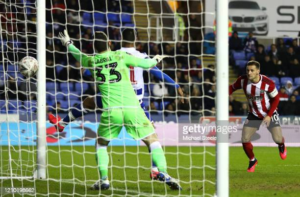 Billy Sharp of Sheffield United scores his sides second goal during the FA Cup Fifth Round match between Reading FC and Sheffield United at Madejski...