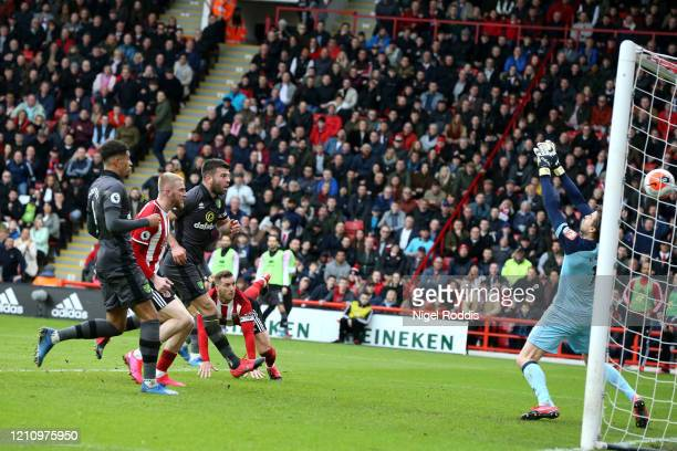 Billy Sharp of Sheffield United scores his team's first goal past Tim Krul of Norwich City during the Premier League match between Sheffield United...
