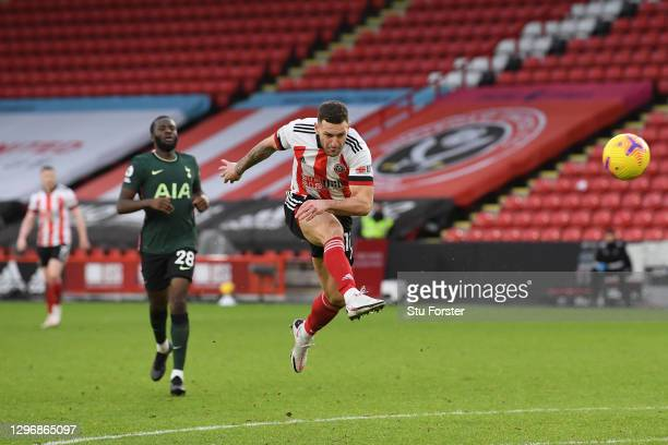 Billy Sharp of Sheffield United shoots wide during the Premier League match between Sheffield United and Tottenham Hotspur at Bramall Lane on January...