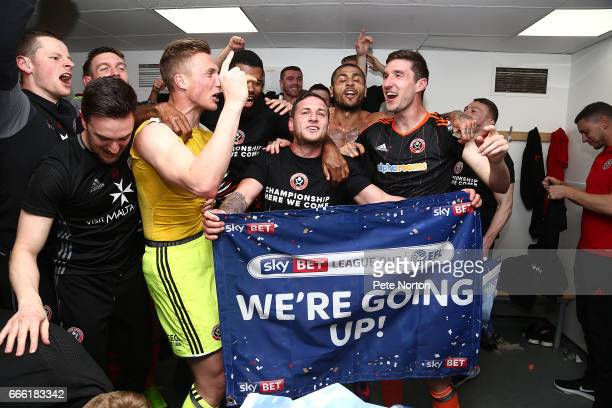 Billy Sharp, Simon Moore and Steve Basham of Sheffield United celebrate after promotion to the Championship after the Sky Bet League One match...