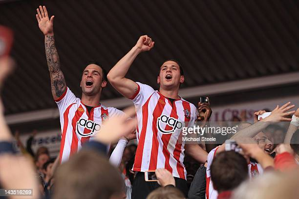 Billy Sharpe and Daniel Fox of Southampton celebrate their sides 40 victory and promotion after the npower Championship match between Southampton and...