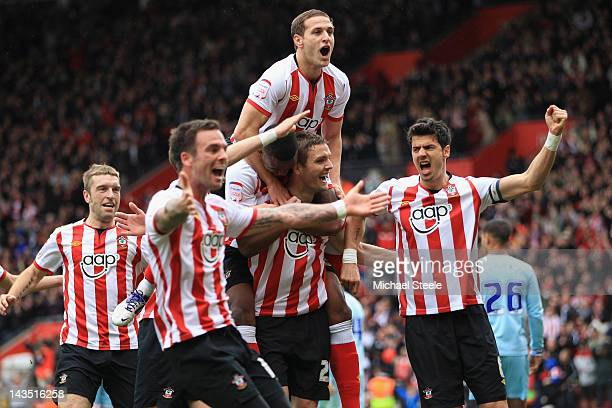 Billy Sharpe of Southampton jumps on the back of goalscorer Jos Hooiveld after the third goal during the npower Championship match between...