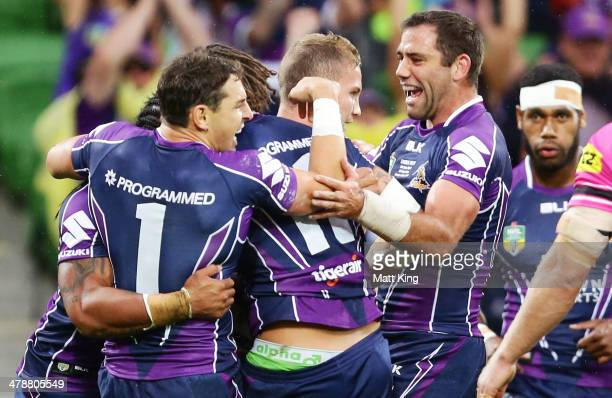 Billy Slater and Cameron Smith of Storm celebrate the try to Kevin Proctor during the round two NRL match between the Melbourne Storm and the Penrith...