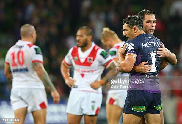 Billy Slater and Cameron Smith of the Storm celebrate winning the round one NRL match between the Melbourne Storm and the St George Illawarra Dragons...