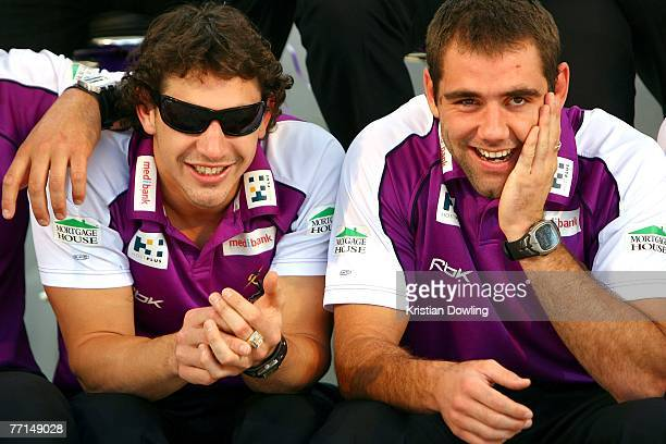 Billy Slater and Cameron Smith of the Storm share a laugh during the Melbourne Storm NRL Grand Final Victory Parade on October 2 2007 in Melbourne...