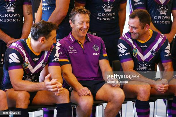 Billy Slater and Cameron Smith talk with head coach Craig Bellamy at the team photoshoot during a Melbourne Storm NRL media opportunity at AAMI Park...