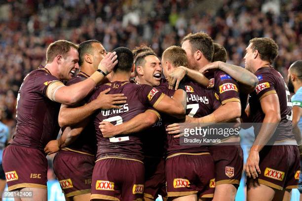 Billy Slater and team mates are seen celebrating after Daly Cherry-Evans of Queensland scores a try during game three of the State of Origin series...