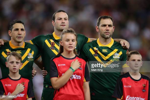 Billy Slater Boyd Cordner and Cameron Smith of the Kangaroos sing the national anthem before the 2017 Rugby League World Cup Final between the...