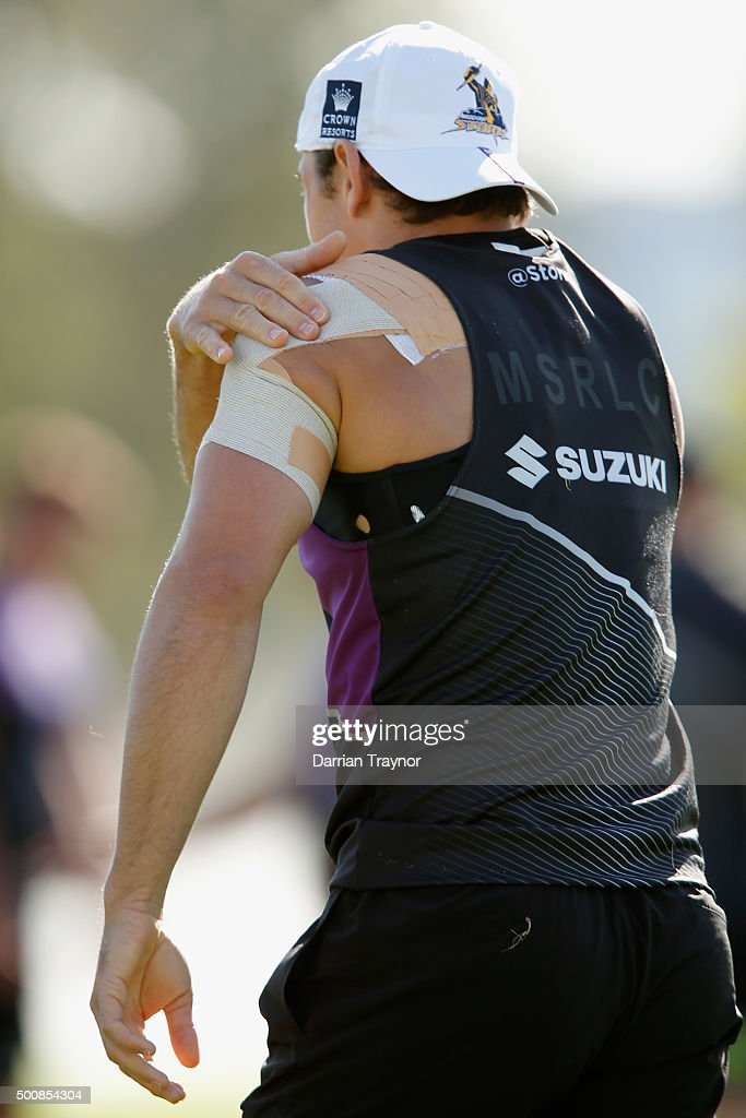 Billy Slater checks the tape on his repaired shoulder during a Melbourne Storm NRL pre-season training session at Gosch's Paddock on December 11, 2015 in Melbourne, Australia.