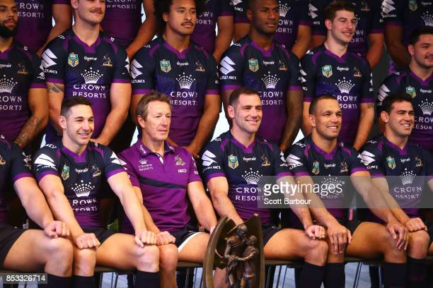 Billy Slater coach Craig Bellamy captain Cameron Smith and Will Chambers pose for their team photo with the ProvanSummons trophy during a Melbourne...