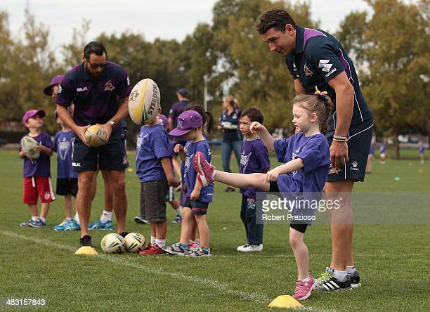 Billy Slater gives instructions to fans during the Melbourne Storm Billy's Buddies school holiday clinic launch at Gosch's Paddock on April 7 2014 in...