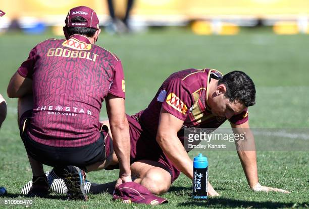 Billy Slater goes down with a leg injury during a Queensland Maroons State of Origin training session at Sanctuary Cove on July 9 2017 in Brisbane...