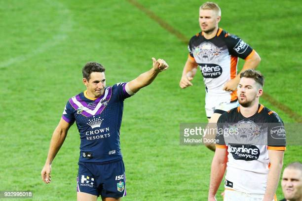 Billy Slater looks gestures to fans after losing in his 300th match during the round two NRL match between the Melbourne Storm and the Wests Tigers...