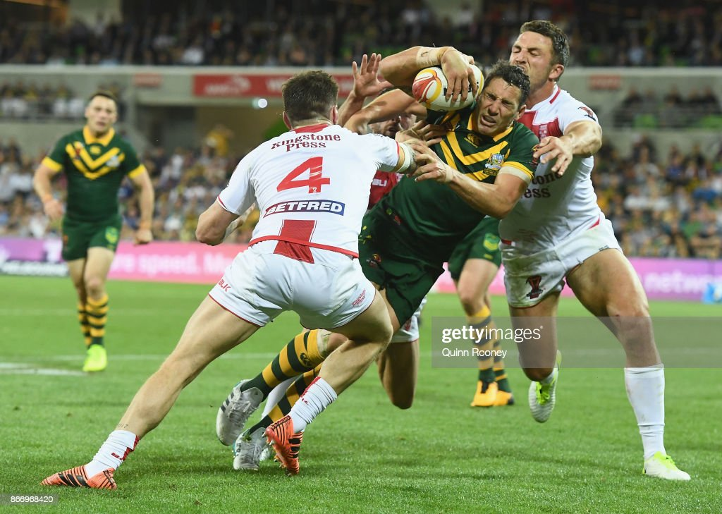 Billy Slater of Australia breaks through a tackle to score a try during the 2017 Rugby League World Cup match between the Australian Kangaroos and England at AAMI Park on October 27, 2017 in Melbourne, Australia.
