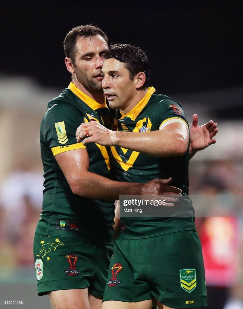 Billy Slater of Australia (R) celebrates with Cameron Smith (L) after scoring a try during the 2017 Rugby League World Cup Quarter Final match between Australia and Samoa at Darwin Stadium on November 17, 2017 in Darwin, Australia.