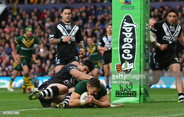 Billy Slater of Australia dives over the line to score the opening try during the Rugby League World Cup Final between New Zealand and Australia at...